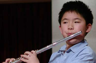 Ware flute student James receives 95 on RCM grade 4 flute Exam