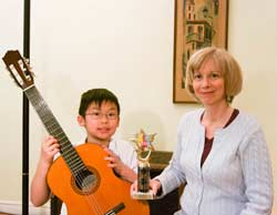 Guitar teacher Lynn Ware with Guitar Student Nicolas Lee winner of the North Yourk Music Festivel Best Junior Guitarist trophy